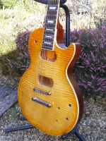 pale amber burst nitrocellulose on flamed maple © 2018 Guitar Angel