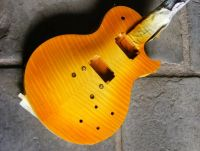 amber burst nitrocellulose on flamed maple © 2018 Guitar Angel