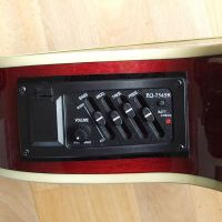 A preamp fitted to an acoustic guitar © 2017 Guitar Angel
